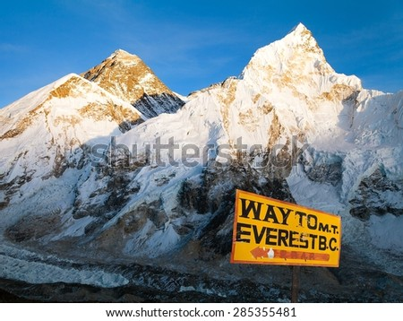 Evening view of Mount Everest from Kala Patthar and signpost way to mount everest b.c. - treking road to Everest base camp - sagarmatha national park - Nepal  and himalayan panorama - stock photo