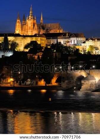 Evening view of  Prague Castle and Charles Bridge over Vltava river from Novotneho Lavka, Prague, Czech - stock photo