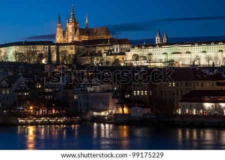 Evening view of Prague Castle over Vltava river, Czech Republic - stock photo