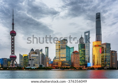 Evening view of Pudong skyline (Lujiazui) in Shanghai, China. Skyscrapers of downtown on waterfront. The Shanghai Tower and the Shanghai World Financial Center (SWFC) are visible at right. - stock photo