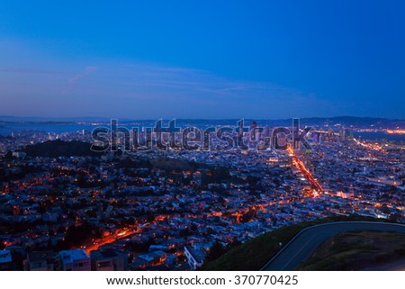 Evening view of San Francisco downtown and houses