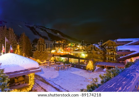 Evening View of ski area & Le Croisette shoppin Area during winter season, Courchevel, France - stock photo