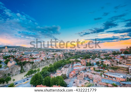Evening View Of Tbilisi At Colorful Sunset. Georgia. Summer Cityscape. Left Side Of The Photo Is Visible The Metekhi Church. Right Side Of The Photo Is Visible The Old Historic District Abanotubani - stock photo