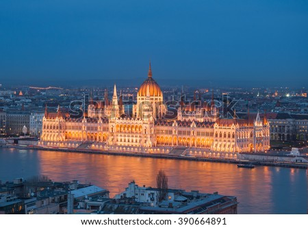 Evening view of the Hungarian Parliament Building on the bank of the Danube in Budapest, Hungary.