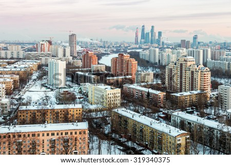 evening view of the residential and financial development of the Moscow winter. Focus on skyscrapers - stock photo