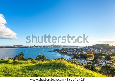 Evening view on Auckland Central, Waitemata harbor and Devonport district. New Zealand - stock photo