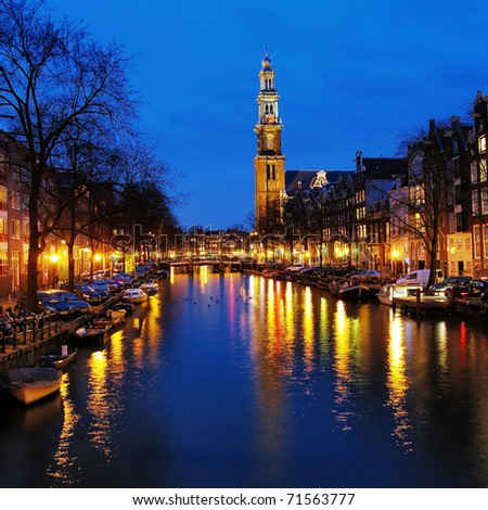 Evening view on the Western church from Prinsengracht channel in Amsterdam, Netherlands - stock photo