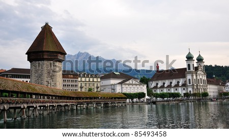 Evening view on wooden Chapel bridge and Jesuit church in old town of Lucerne, Switzerland