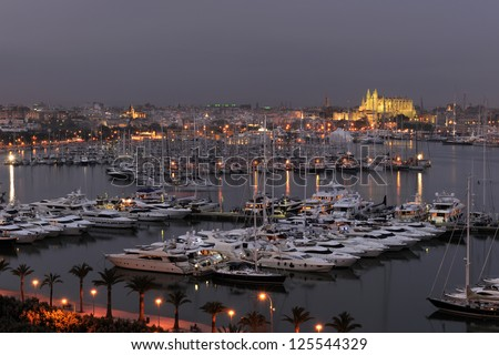 Evening view over the Bay of Palma and Club de Mar with La Seu cathedral in background, Mallorca, Balearic Islands, Spain, Europe - stock photo