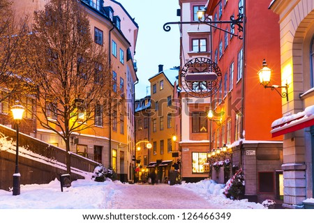 Evening winter scenery of street in Old Town (Gamla Stan) in Stockholm, Sweden - stock photo