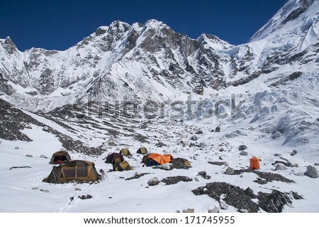 EVEREST BASE CAMP, NEPAL - CIRCA OCTOBER 2013: expedition at Everest Base Camp  circa October 2013 in Everest Base Camp. - stock photo