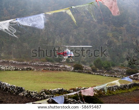 EVEREST REGION, NEPAL - 4 OCTOBER: helicopter on his way to rescue an injured or sick climber in 4 October 2008 in the Everest base camp trek in Nepal. propably because of altitude sickness - stock photo