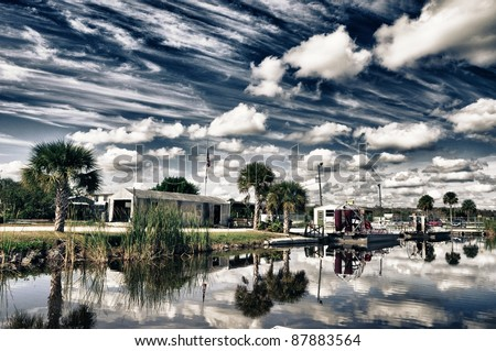 Everglades mood with clouds, water and trees in hdr - stock photo