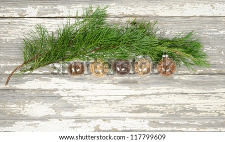 Evergreen bough with grain filled transparent glass baubles
