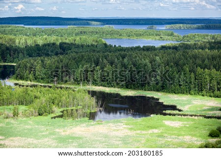 Evergreen woods and blue lakes in Karelia, aerial view - stock photo