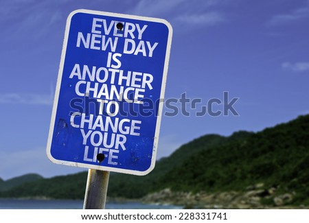 Every New Day is Another Chance to Change your Life sign with a beach on background - stock photo