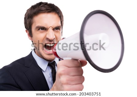Everybody listen to me! Angry young African man in formalwear shouting at megaphone while standing isolated on white background  - stock photo