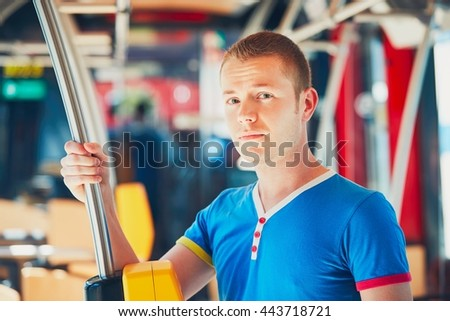 Everyday life and commuting to work by public transportation. Handsome young man is traveling by bus (tram).  - stock photo