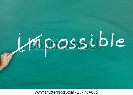Everything is possible concept on green blackboard - stock photo