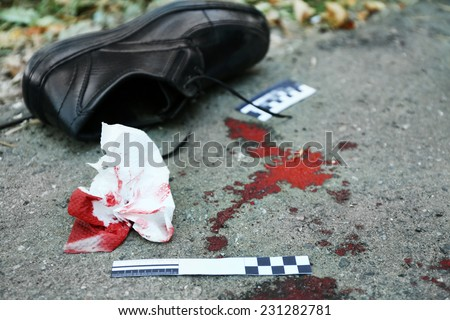 Evidence and blood on crime scene  - stock photo