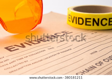evidence bag with forensic tool for crime scene investigation - stock photo
