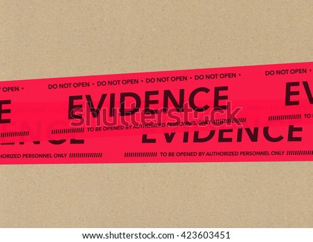 Evidence tape on cardboard - stock photo