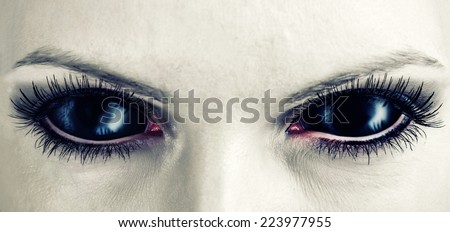 Evil black female alien, vampire or zombie eyes. dirt make up. Macro. Halloween theme  - stock photo