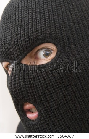 evil criminal wearing military mask - stock photo