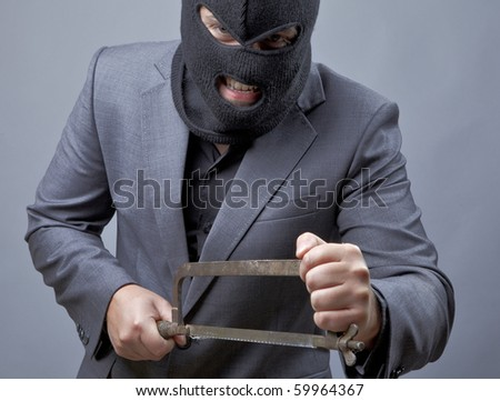 Evil criminal wearing military mask isolated on gray background. - stock photo