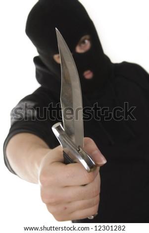 evil criminal with a knife wearing balaclava - stock photo