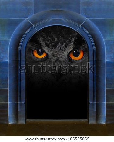 Evil eye in ancient stone gate. Horror scene with space for your text. - stock photo