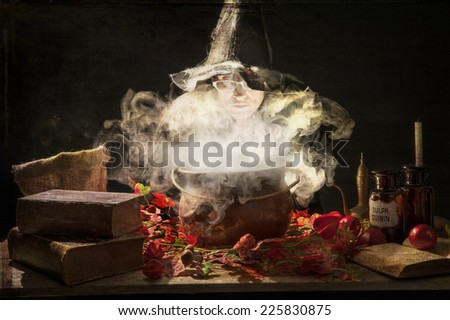 evil halloween witch making a potion in a copper cauldron