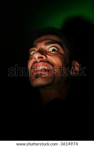 Evil looking man - stock photo