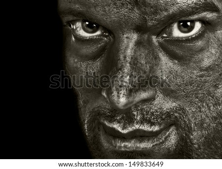 Evil man showing terror emotion and darkness in the intense eyes and sarcasm in the smile. In Black and White. - stock photo