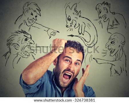 Evil men pointing at stressed anxious guy. Portrait desperate young businessman frustrated screaming isolated on grey wall background. Negative human emotions face expression feelings life perception - stock photo
