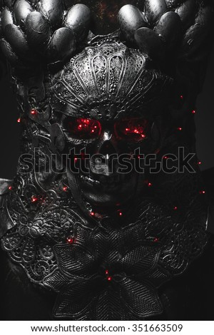 Evil, silver armor skull with red eyes and led lights, helmet metal filigree