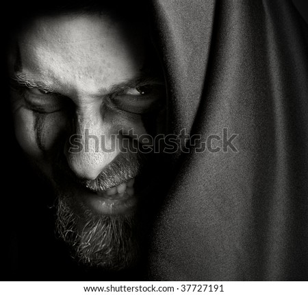 Evil sinister man with malefic grin - stock photo