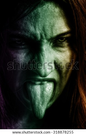 Evil spooky woman with scary horror face  - stock photo