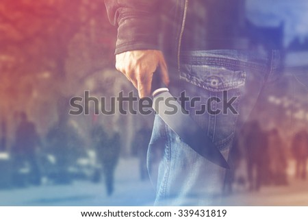Evil terrorist man with shiny knife, a killer person with sharp knife about to commit an act of violence or terrorism, homicide, murder scenery, double Exposure - stock photo