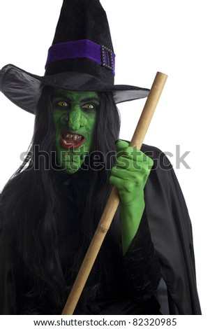 Evil witch and her broom, white background. - stock photo