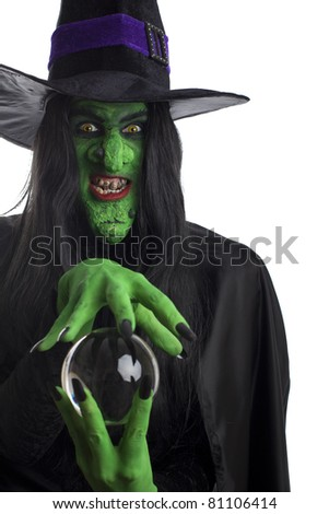Evil witch and her crystal ball, white background. - stock photo