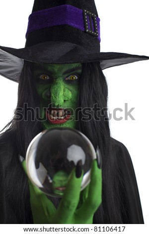 Evil witch looking into her crystal ball, white background. - stock photo