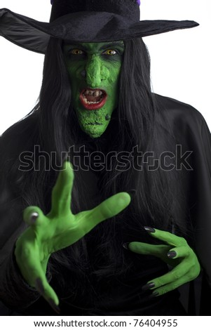 Evil witch looking to attack. White background. - stock photo