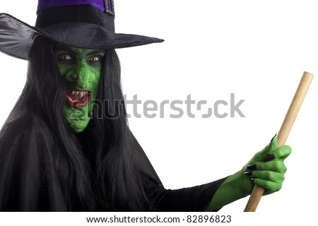Evil witch on her broomstick, white background. - stock photo
