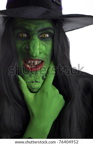 Evil witch, rubbing her chin. White background. - stock photo