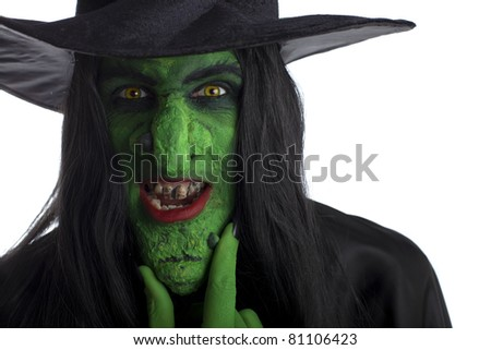 Evil witch rubbing her chin, white background. - stock photo
