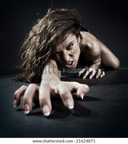 evil woman creeping from dark - stock photo