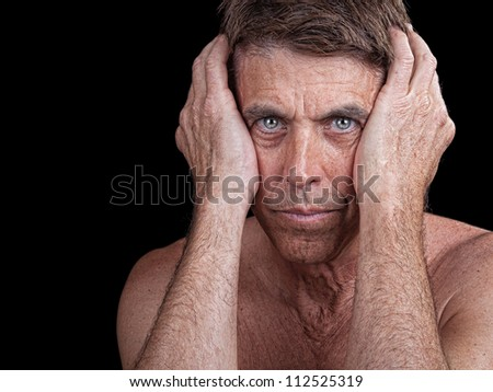 Evocative portrait of a lonely middle aged man. - stock photo