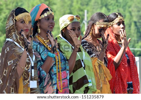 EVOLENE, SWITZERLAND - AUGUST 13: Djibouti dancers in line at the International Festival of Folklore and Dance from the mountains (CIME) :  August 13, 2013 in Evolene Switzerland