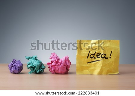 Evolving idea concept crumpled paper ball brainstorming for a good idea - stock photo